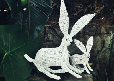 Crochet recycled plastic rabbits over wire frame