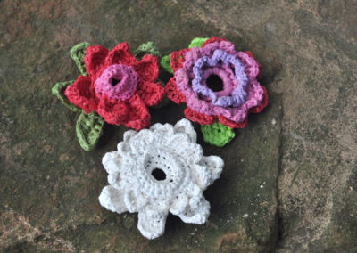Hard plastic crochet brooches